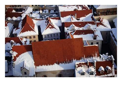 Snow On Rooftops Of Old Riga Town Seen From Spire Of St John's Church, by 	Jonathan Smith